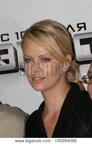 MOSCOW - JUNE 19: Charlize Theron burst into laughter before holding a press conference , prior to the Russian premiere of 'Hancock' on XXX Moscow film festival on June 19, 2008 in Moscow, Russia