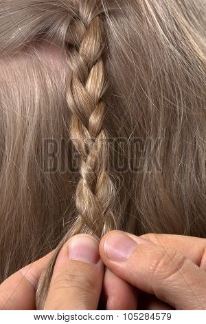 Hands Of Hairdresser Weaving Braid Her Client