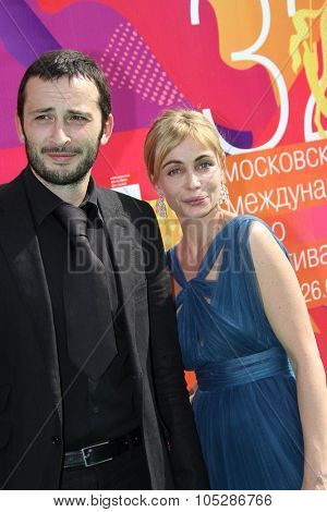 MOSCOW - JUNE 26: Emmanuelle Beart and Michael Cohen attend the closing ceremony of 32nd Moscow Film Festival on June 26, 2010 in Moscow, Russia