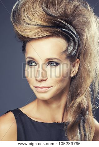 young elegant woman with creative hair style zebra print close up pretty like punk studio