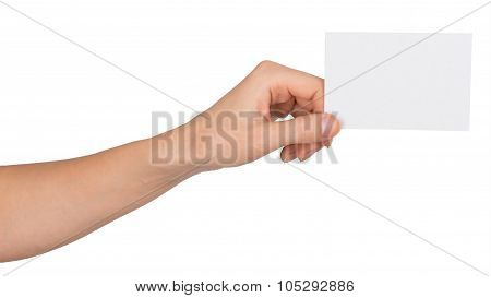 Humans left hand with small blank paper