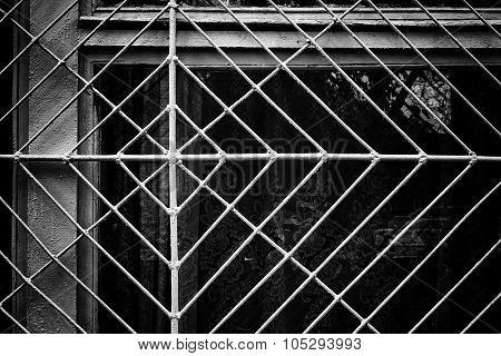 Metal Spider Web Windowframe In Monochrome