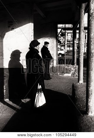 Fur Hat Woman Waiting At Bus Stop