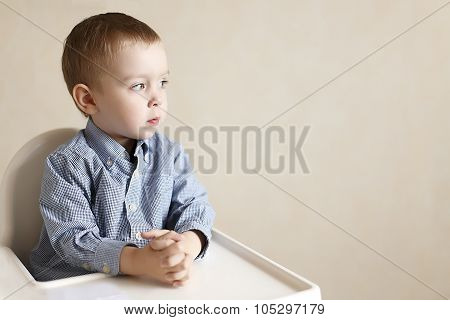 young businessman in a child seat at the meeting