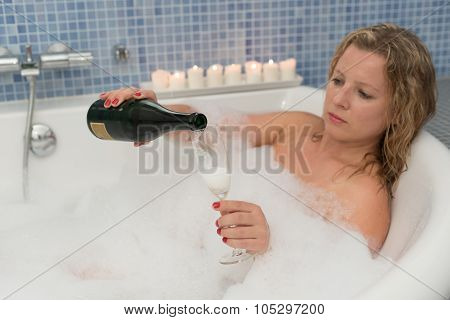 Woman With Champaigne In Bathtub