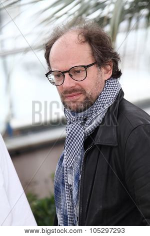 CANNES, FRANCE - MAY 21: Denis Podalydes poses at 'Vous N'avez Encore Rien Vu' Photocall during the 65th Annual Cannes Film Festival at Palais des Festivals on May 21, 2012 in Cannes, France.