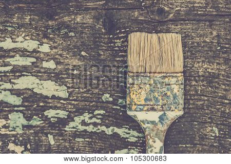 Old Used Paint Brush On Rustic Wooden Board