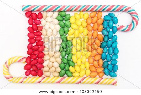 Background with bonbons and candy canes