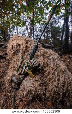 Sniper Reload His Rifle In Forest