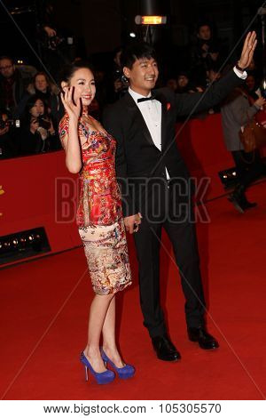 BERLIN, GERMANY - FEBRUARY 15: Guo Xiaodong; Cheng Li Sha arrive for the closing ceremony during 64th Berlinale  Festival at Berlinale Palast on February 15, 2014 in Berlin, Germany.