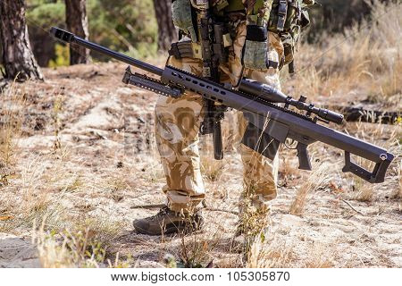 Soldier With Big Sniper Rifle In Forest