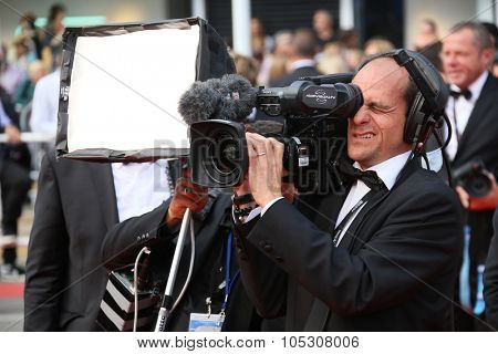 CANNES, FRANCE - MAY 25: Cameraman attends the red carpet for the Palme D'Or winners at the 67th Annual Cannes Film Festival on May 25, 2014 in Cannes, France.