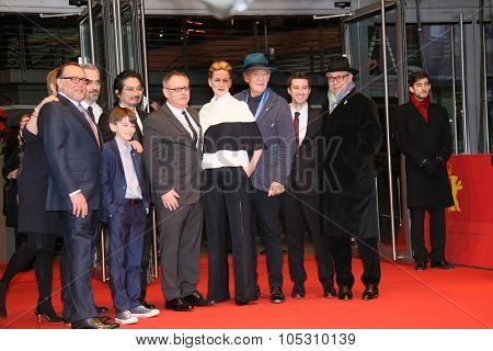BERLIN, GERMANY - FEBRUARY 08: Milo Parker, Ian McKellen, Bill Condon attend the 'Mr. Holmes' premiere during the 65th Film Festival at Berlinale Palace on February 8, 2015 in Berlin, Germany.