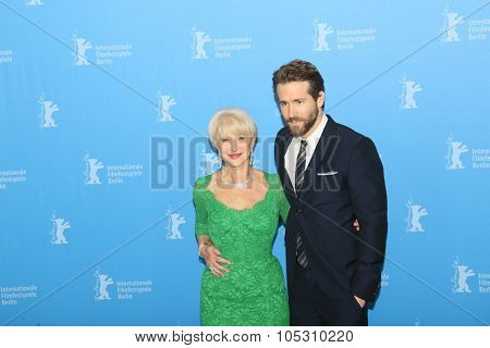 BERLIN, GERMANY - FEBRUARY 09:  Helen Mirren, Ryan Reynolds attend the 'Woman in Gold' photocall during the 65th Berlinale Festival at Grand Hyatt Hotel on February 9, 2015 in Berlin, Germany.