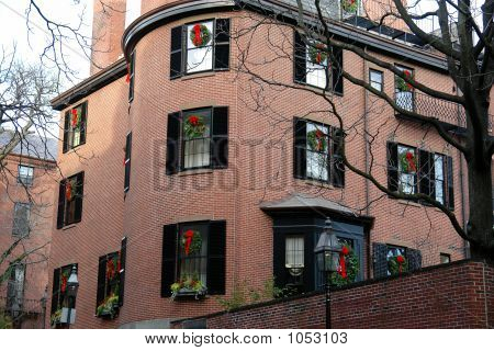 Buliding With Christmas Wreath In Every Window