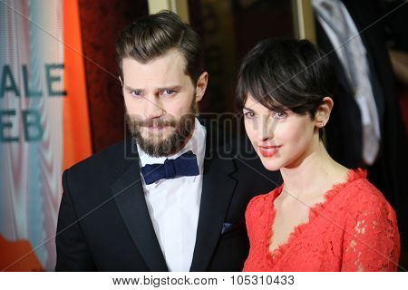 BERLIN, GERMANY - FEBRUARY 11: Jamie Dornan, Amelia Warner attend the 'Fifty Shades of Grey' premiere during the 65th Berlinale Film Festival at Zoo Palast on February 11, 2015 in Berlin, Germany.