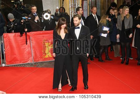 BERLIN, GERMANY - FEBRUARY 11: Jamie Dornan, Dakota Johnson and attend the 'Fifty Shades of Grey' premiere during the 65th Berlinale  Festival at Zoo Palast on February 11, 2015 in Berlin, Germany.