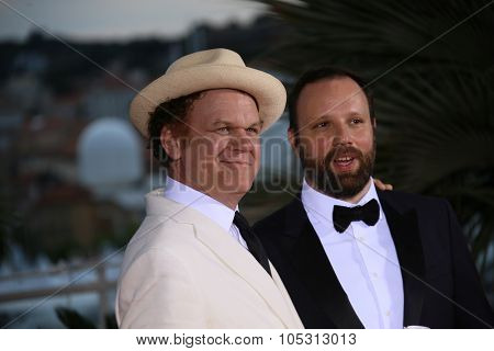 Greek director Yorgos Lanthimos  with John C. Reilly attend a photocall for the winners of the Palm D'Or during the 68th annual Cannes Film Festival on May 24, 2015 in Cannes, France.