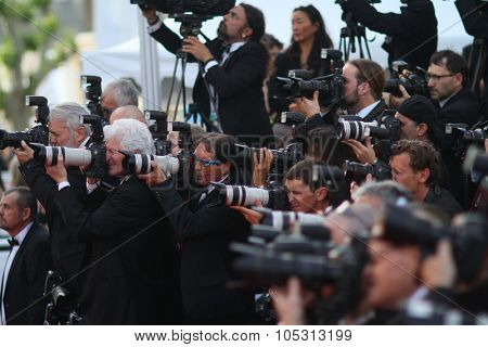 Photographer attends the opening ceremony and 'La Tete Haute' premiere during the 68th annual Cannes Film Festival on May 13, 2015 in Cannes, France.