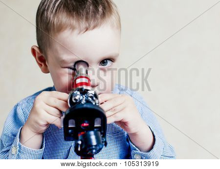 child looking in a microscope