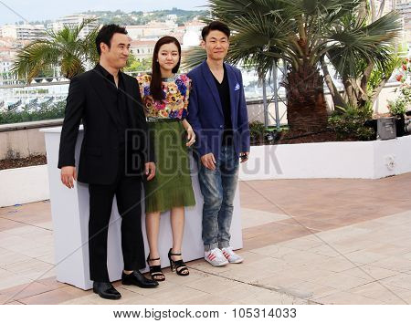 Actor Bae Sung- Woo, Actress KO Ah-Sung and Director Hong Won-Chan attend the 'O Piseu' Photocall during the 68th annual Cannes Film Festival on May 19, 2015 in Cannes, France.