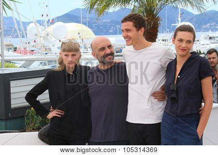 Klara Kirstin, Gaspar Noe, Karl Glusman and Aomi Muyock attend the 'Love' photocall during the 68th annual Cannes Film Festival on May 21, 2015 in Cannes, France.