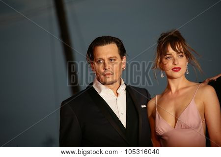 Johnny Depp and  Dakota  Johnson attend the premiere of the movie 'BLACK MASS' during the 72nd Venice Film Festival on September 4, 2015 in Venice, Italy.