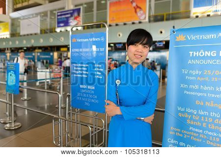 HANOI, VIETNAM - MAY 11, 2015: Vietnam Airlines staff in the airport. Vietnam Airlines has a network within East Asia, Southeast Asia, Europe and Oceania.
