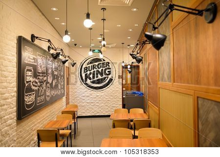 SHENZHEN, CHINA - AIPRIL 15, 2014 : interior of Burger King restaurant in Bao'an airport. Burger King, often abbreviated as BK, is a global chain of hamburger fast food restaurants