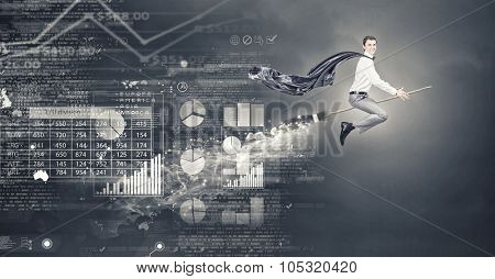 Young businessman flying on broom and growth concept