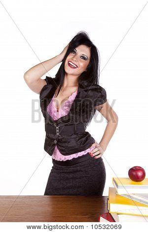 Teacher Behind Desk Hand In Hair