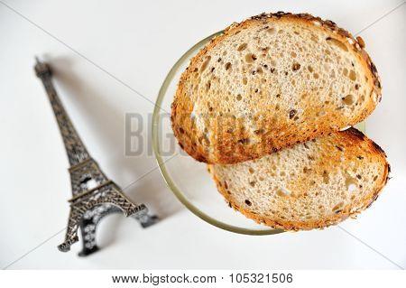 Fresh crispy multigrain toasts and souvenir Eiffel Tower