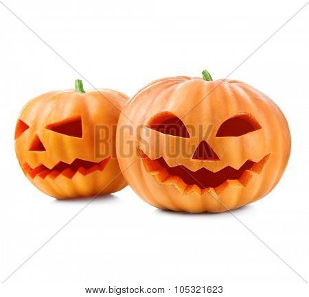 Halloween pumpkin head jack lantern with burning candles isolated on white background. Halloween holidays art design, celebration. Carved Halloween Pumpkins