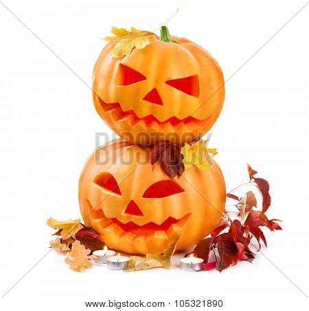 Halloween pumpkin head jack lantern with burning candles isolated on white background. Halloween holidays art design, celebration. Two Carved Halloween Pumpkins