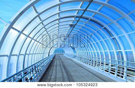 Glass bridge tunnel over road inside