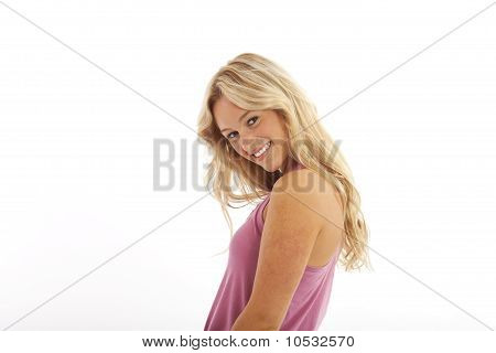 Teenager with long blond hair looking over shoulder