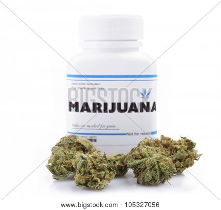 Bottle of dry medical cannabis isolated on white