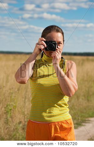 Senior Woman With Photocamera