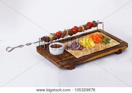 kebab skewers of meat on a stick board