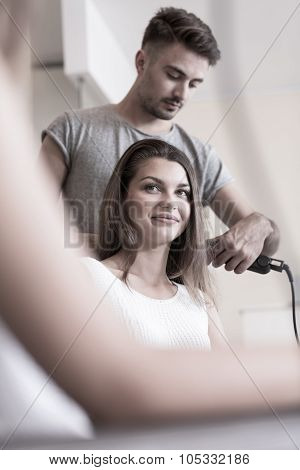 Doing Young Woman's Hair