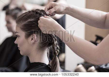 Braiding Young Woman's Hair