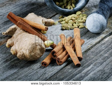 Still-life Of Spice And Mortar On A Wooden Table