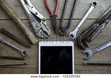 Old Tools And Tablet On A Wooden Table
