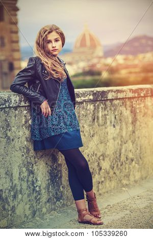 Portrait of young and beautiful girl in Florence, Italy. In background Cathedral Santa Maria del Fiore