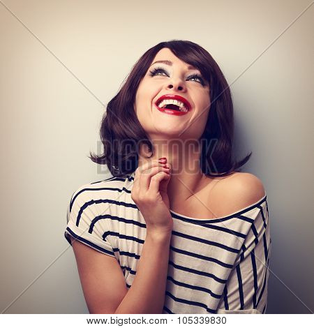 Happy Loudly Laughing Young Casual Woman Looking Up. Vintage Closeup Portrait