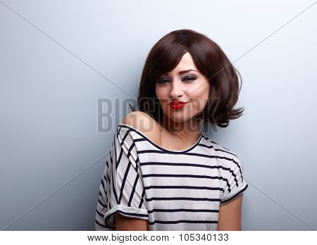 Cool Grimacing Young Woman With Short Black Hairstyle And Red Lips Joying