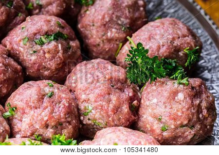Raw meat balls. Prepared uncooked meat balls in a metal tray.