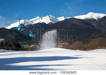 Bansko cable car cabin and snow peaks, Bulgaria