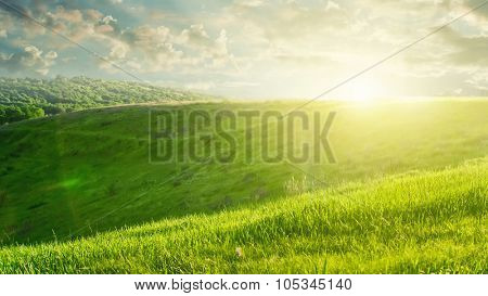summer landscape on sunset with green field and beautiful clouds. Header for website