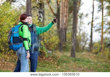 people hiking, man and woman looking around nature landscape scenic